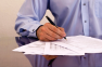Businessman_Signing_Papers_3466551Large